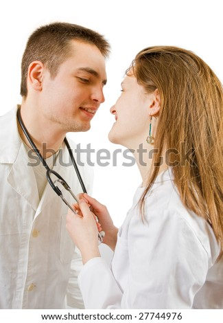 A male and a female doctor kissing at work. - stock photo