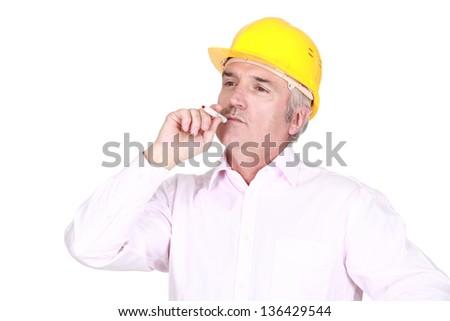A male architect smoking. - stock photo