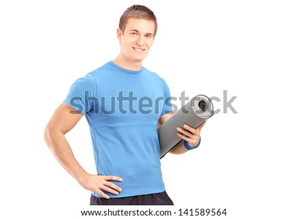 A male athlete holding a mat isolated on white background - stock photo