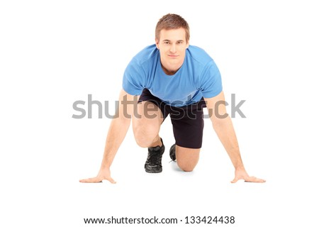 A male athlete ready to run isolated on white background - stock photo