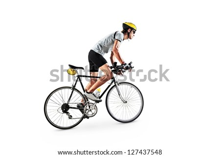 A male bicyclist riding a bicycle isolated against white background - stock photo