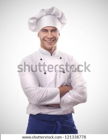 A male chef isolated over grey gradient background - stock photo