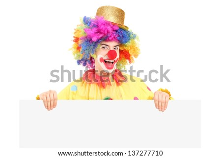 A male clown with happy joyful expression holding a blank panel isolated on white background