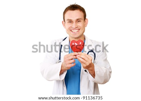 A male doctor holding a heart, isolated on white background - stock photo
