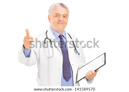 A male doctor standing and giving a thumb up isolated on white background - stock photo