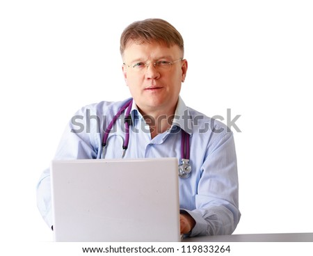 A male doctor working at a workplace, isolated on white background - stock photo
