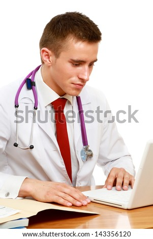 A male doctor working at desk, isolated on white background - stock photo