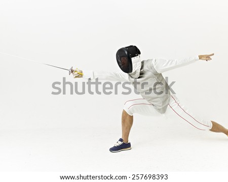 a male fencer attacking opponent.