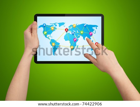 A male hand holding a modern tablet with social map - stock photo