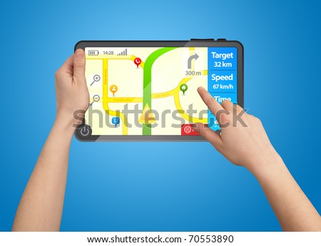 a male hand holding a touchpad gps, one finger touches the screen