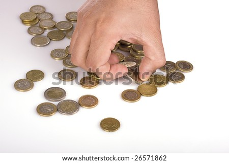A male hand picking some euro coins