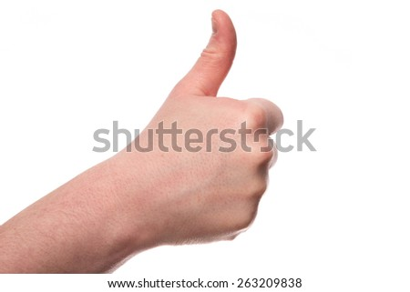 A male hand sticks a thumb up isolated on a white background - stock photo