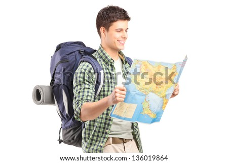 A male hiker looking at map isolated on white background - stock photo