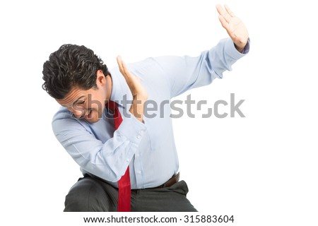 A male hispanic victim white collar office worker protecting himself with hands up in defensive position from workplace physical, verbal abuse, violence. Horizontal - stock photo