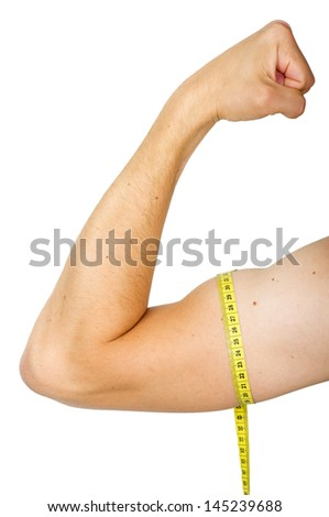 a male muscles with measuring tape isolated on white background - stock photo