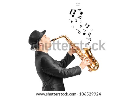 A male playing on saxophone and notes coming out isolated against background - stock photo