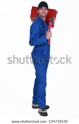 A male plumber. - stock photo