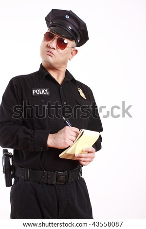 A male police officer writing a citation. - stock photo