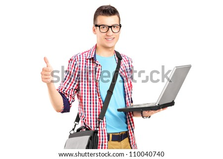 A male student working on a laptop and giving thumb up isolated on white background - stock photo