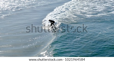 A male surfer enjoying the waves in the morning
