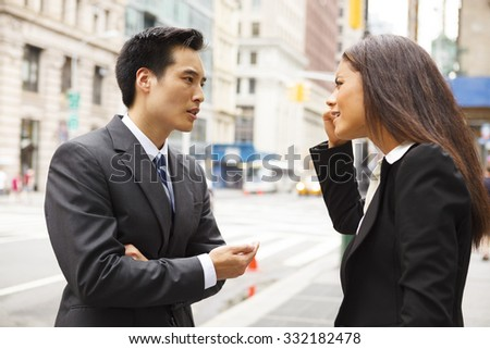 A man and a woman arguing on a city street.