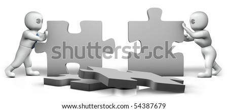 a man and a woman building a puzzle - stock photo