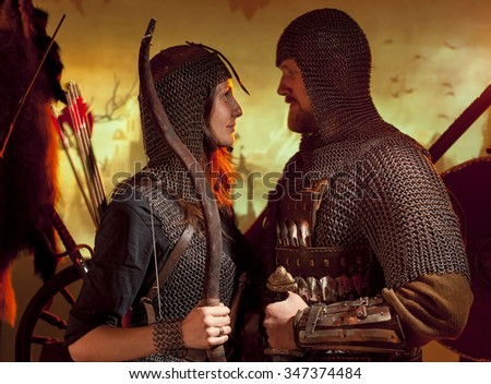 a man and a woman dressed as a medieval knight - stock photo