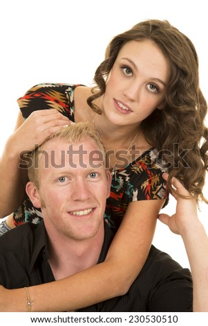 A man and woman close together. She is hugging him in her arms. - stock photo
