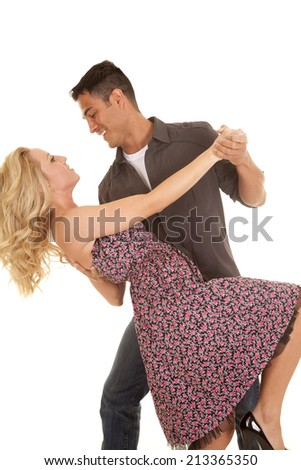 A man and woman dancing looking into each others eyes. - stock photo