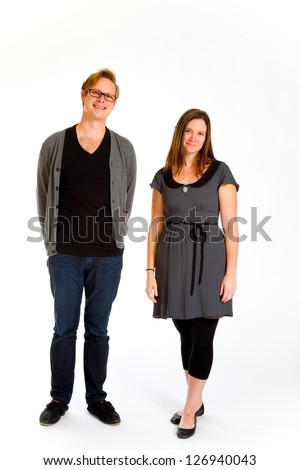 A man and woman pose for this family portrait in the studio against an isolated white background.