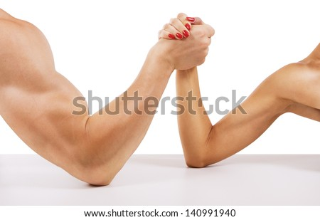 A man and woman with hands clasped arm wrestling, isolated on white - stock photo