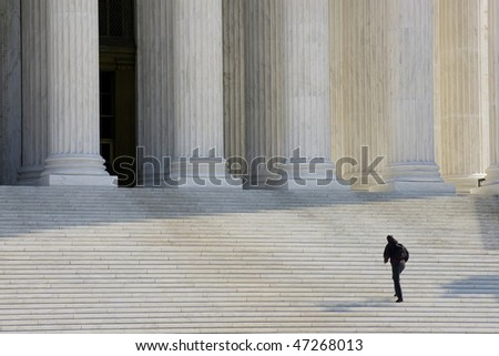 A man approaching the entrance to the Supreme Court in Washington DC