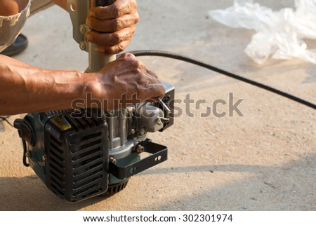 A man assemble brush cutter engine - stock photo