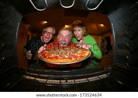 A Man bakes his signature Smiley Face Cookies in his oven for his hungry family and friends. Shot from the Inside of the oven facing out showing a unique view not often seen.