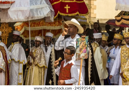 A man blows a traditional a traditional horn announcing the arrival of the tabot, representation of the arc of the covenant, during Timket (Epiphany) celebrations, on January 19, 2015 in Addis Ababa. - stock photo