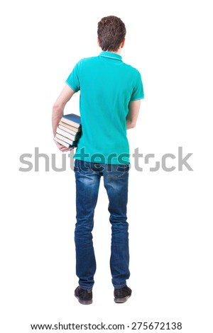 A man carries a heavy pile of books. back view.  backside view of person.  Isolated over white background. Clutching a stack of books under his arm man standing and looking into the distance. - stock photo