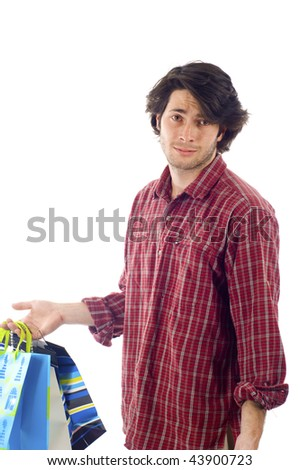 A man carrying his girlfriend / wife's shopping bags , he looks a bit unhappy, isolated over a white background