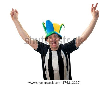 A man celebrating a goal at a football match on a white background.