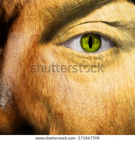A man changing into a werewolf with slit pupil - stock photo