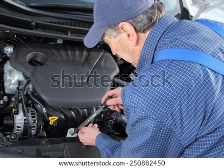 A Man checking Frost protection of  coolant in car - stock photo