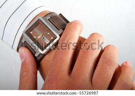 A man checking the time on his wrist watch