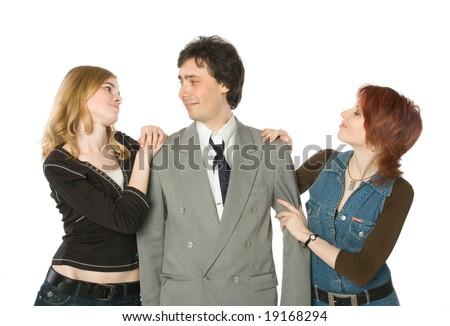 A man choosing between two young women - stock photo