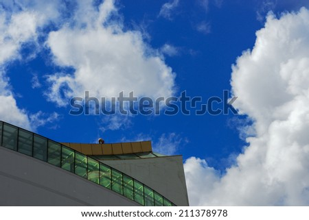 A man cleaning  on a high rise building