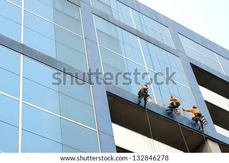 A man cleaning windows - stock photo