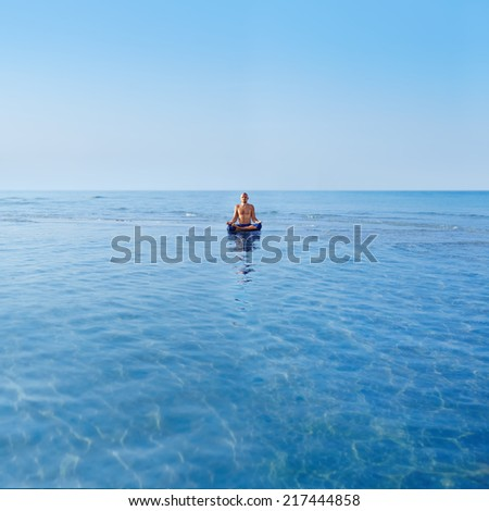 A man comes in harmony and tranquility upon the ocean - stock photo
