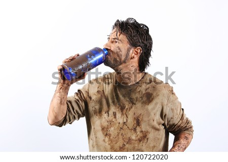 A man covered in mud trying to survive - stock photo