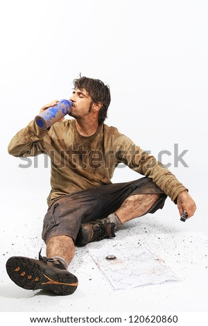 A man covered in mud with a rope, trying to survive - stock photo
