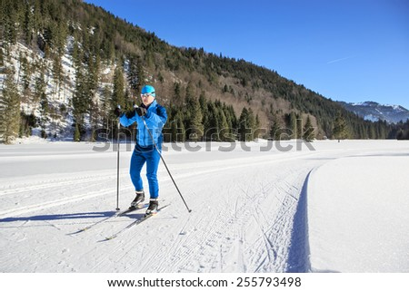 A man cross-country skiing on the trail in Bavaria - stock photo
