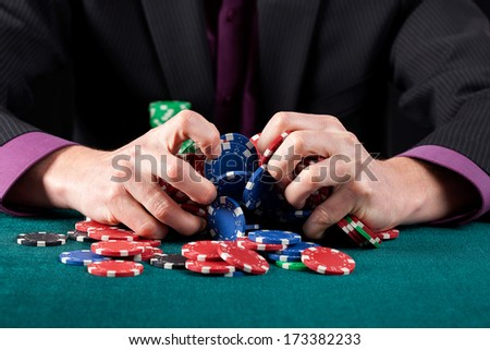 A man destroying heaps of casino chips after a failure