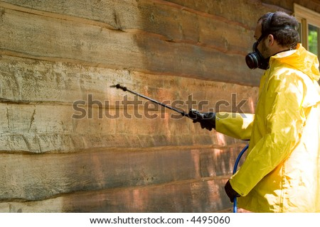 a man doing a chemical wash on a garage - stock photo